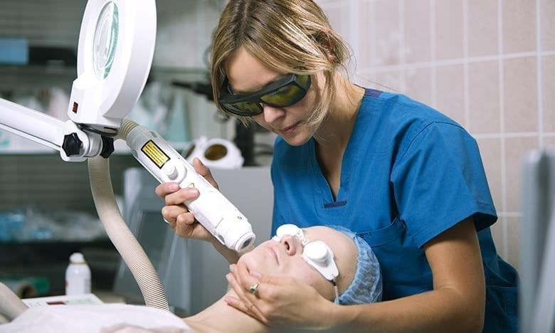 client receiving laser treatment
