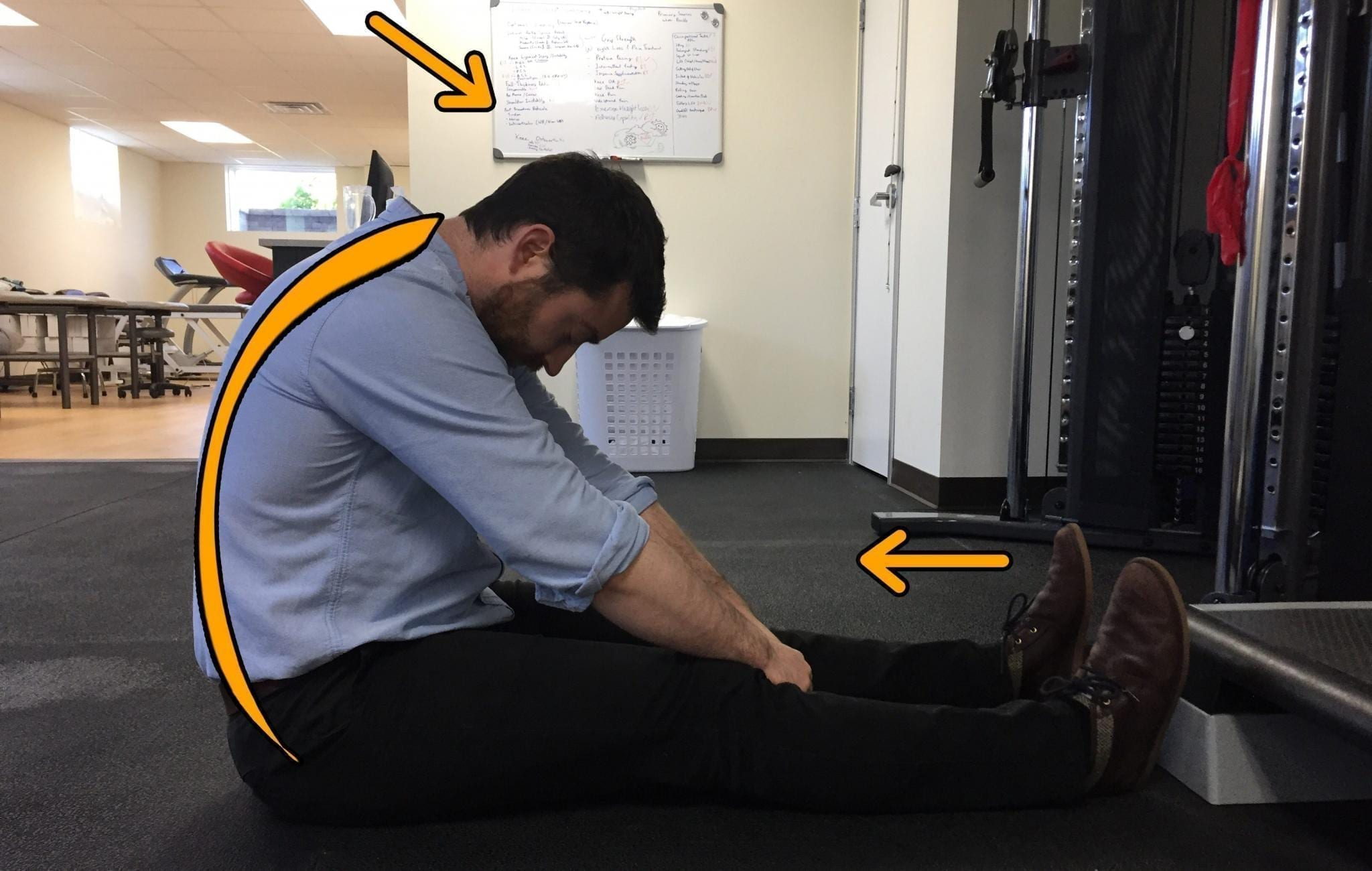 Chiropractor performing a Slump Stretch for Hamstrings