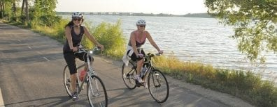 women biking, doing exercise
