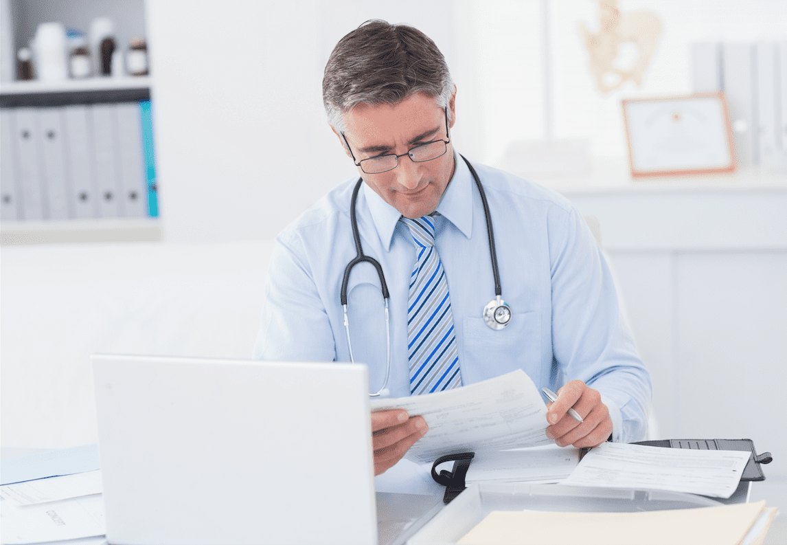 Doctor reading medical article
