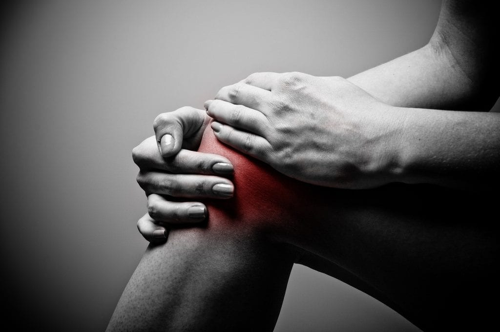 Man suffering from knee osteoarthritis