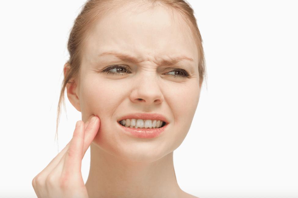 TMJ-woman Treating TMJ Disorder